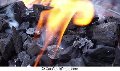 Coal - Charcoal burning on a barbecue