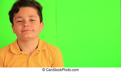 Smiling child with chroma green screen - Close up portrait...