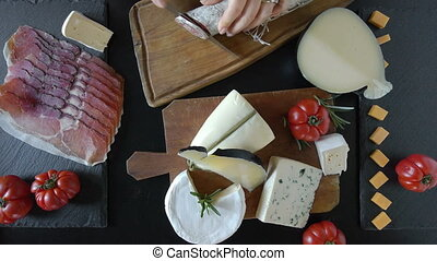 Various Cheese And Salami - Top view of table with various...