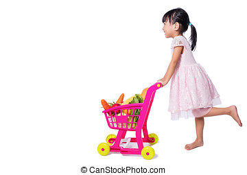 Asian Chinese little girl with shopping trolley full of vegetables