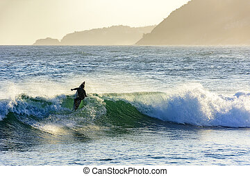 Surf at sunset in Arpoador beach in Ipanema Rio de Janeiro -...