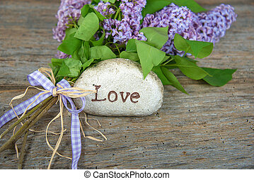 word love on rock with lilacs