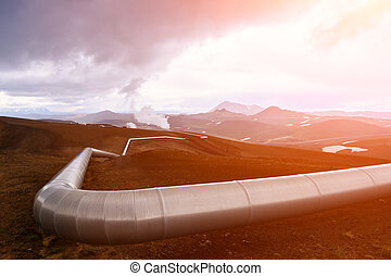 Geothermal - Iceland landscape with pipes in mountains....