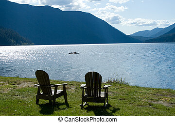 Lakeside Retreat - Two chairs rest peacefully beside the...
