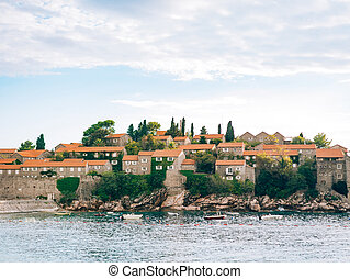 Island of Sveti Stefan close up at sunset. Montenegro, the...