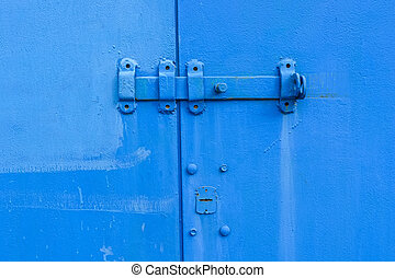 Old blue door hinge - Close-up old blue door hinge on metal...