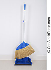 broom and dustpan on floor with wall background - broom and...