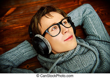 good musical mood - Happy young man listens to music in...