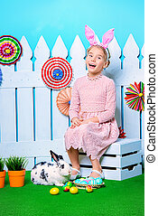 spring Easter holiday - Cute happy little girl sitting with...