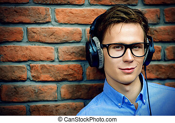 man in headphones - Happy young man listens to music in...