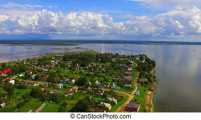 Aerial view on the settlement on the bank of lake - Aerial...