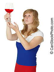 Woman - taster checks color and opacity of wine - The woman...