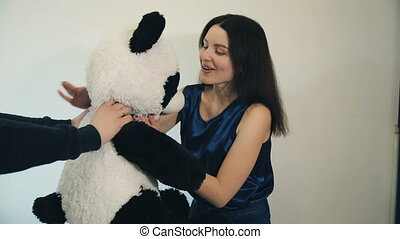 Woman received a teddy bear - Happy woman with a panda on...