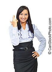 Young executive woman holding fingers crossed isolated on...
