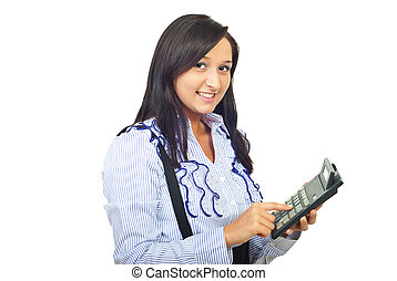 Happy woman type on calculator
