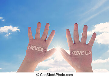 Never Give Up Concept - Never give up hands on blue sky...