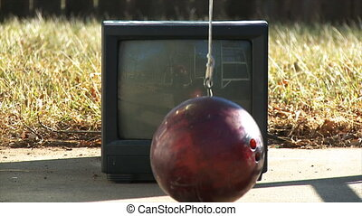 Bowling Ball vs. Television - An old analog television is...
