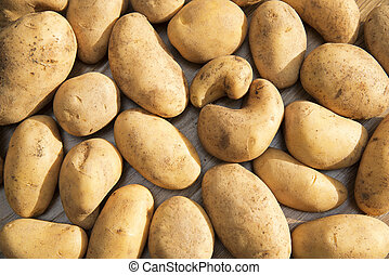 Potatoes raw vegetables food in market for pattern texture and background.