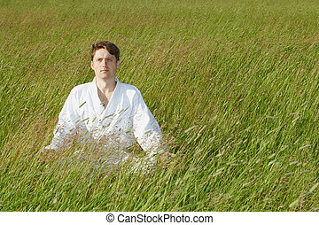Man sits in grass