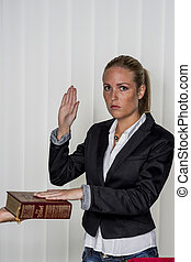 woman swears on the bible - a woman says as a witness in...