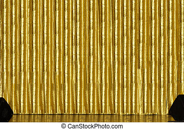 Stage with golden curtain - A stage with golden curtain and...