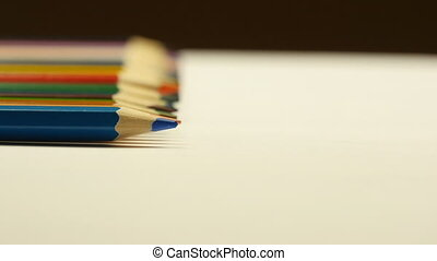 Rolling colored pencils - Rolling colored pencil on white...