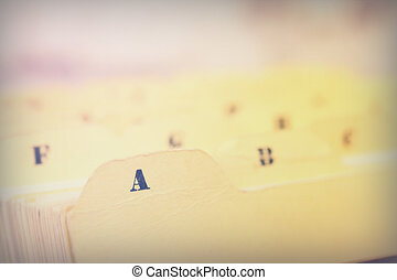 Close up of alphabetical index cards in box