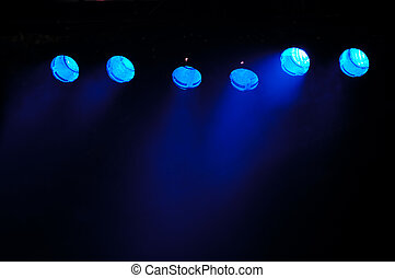 Blue spotlights - Lights and smoke. Row of blue lights from...