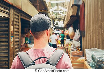 Traveler in Asia - Young traveler with backpack in street...