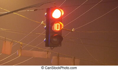 Close-up of traffic lights with timer from red to green at...