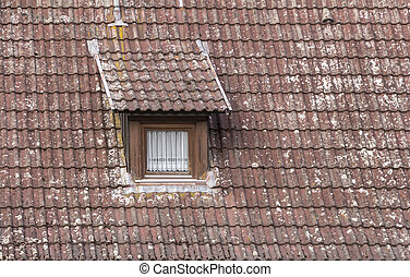dormer with window - detail of a old roof with dormer and...