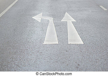 Go straight or turn left traffic sign on paved road - Go...