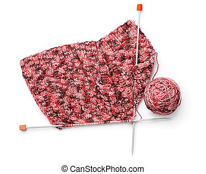 Top view of knitting with needles and yarn bal