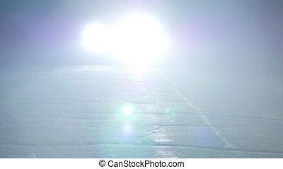 Car rides at night and blink of car headlights.