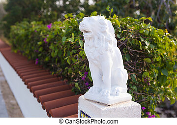 Stone lion statue is situated in front of hotel