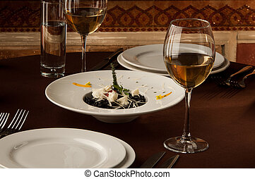 served table with glasses of wine on the background of...