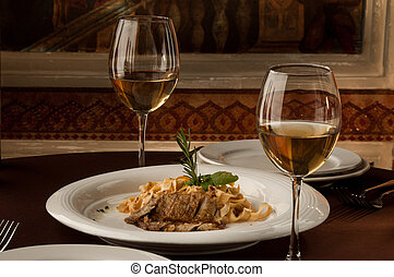 served table with glasses - served table with a meat dish...