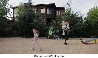 Happy and funny children running around the playground