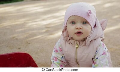 Little girl walking on the playground - Little girl in the...