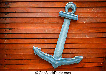 Wooden nautical anchor on wooden background