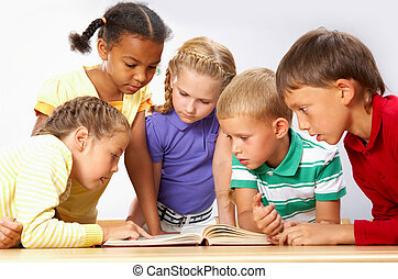 Reading - Portrait of pupils looking at page of...