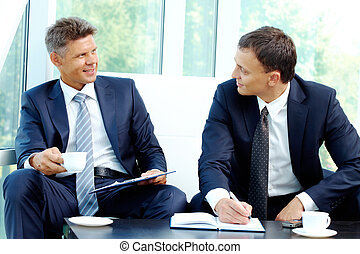 Working together - Image of smart businessmen discussing new...