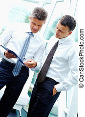 Explaining idea - Two smart businessmen discussing new...