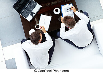 Interacting men - Image of two businessmen discussing work...