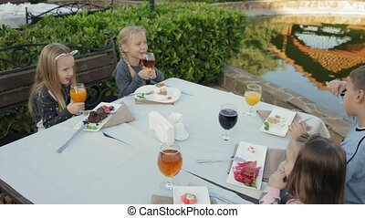 Children eating at the outdoor cafe - Children eating...