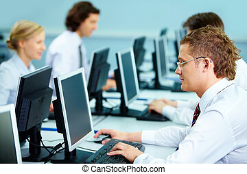 Busy people - Smart businesspeople typing at workplaces in...
