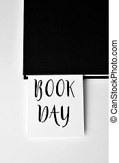 book and text book day - closeup of a piece of paper with...