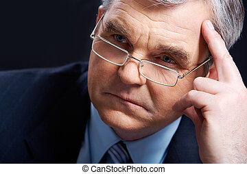 Pensive man - Photo of senior employer thinking about...