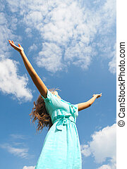 Surrender - Image of happy female standing with raised arms...