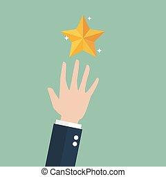 Hand grabbing a golden star. Dream big concept